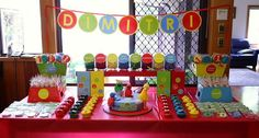 colorful Sesame Street 1st Birthday with a circle theme & colorful bins