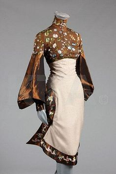 An Alexander McQueen for Givenchy couture wildflower embroidered gown, probably Autumn-Winter, 1999, un-labelled, the brown chiffon bodice with Lesage embroidery of blossom and foliage,