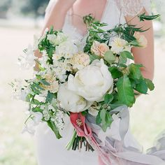 An incredibly lush bridal bouquet in shades of white by The Nouveau Romantics.