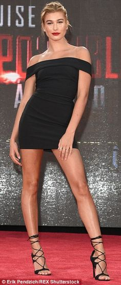 Fit to be tied: The Vogue magazine knockout had on lace-up heels that showed off tanned st...