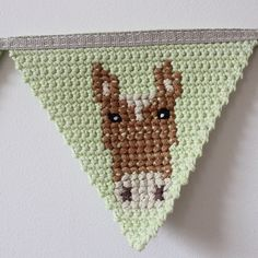 SnapWidget | Crochet bunting with cross-stitch. #handmade #bunting #crochet #thefoxintheattic #horse