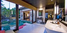 Anantara Phuket Villas: Silk-swathed alfresco daybeds and carved teak accents define the Lagoon Pool Villas.