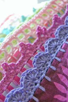 These are crochet pillow case trim ideas, but can be used to embellish a cute print receiving blanket.
