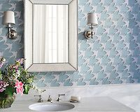 Flock, a stone and Serenity glass waterjet mosaic, shown in Infinity glass and polished Calacatta, is part of the Altimetry Collection for New Ravenna.