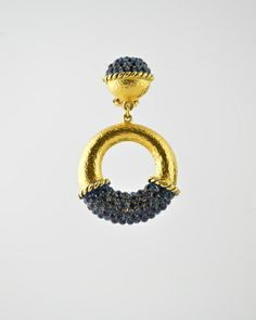 24 Karat gold plated hammered drop hoop earring with Austrian crystal detail in Navy blue stones. Earring is 2 inches tall and 1 inches at widest point. Earring is a clip. Chandler Earrings, Jewelry Chest, Hammered Gold, Austrian Crystal, Gold Hoops, Blue Fashion, Fashion Boutique, Studs, Crochet Earrings