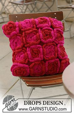 """Ravelry: 124-6 Cushion cover with crochet flowers in """"Eskimo"""" pattern by DROPS design"""