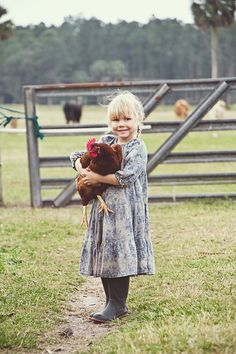 Little chicken lady. this is the kind of life I want to be able to give my future children..