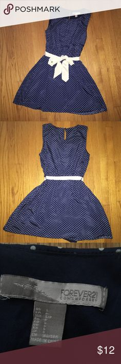 """FOREVER21 NAVY BLUE DRESS WITH WHITE POLKA DOTS NO FLAWS/// I AM 5'2""""  I've only worn this once for my softball banquet lol modeled in last pic!!!! Although the it's size small, the waist has an elastic band that stretches a lot. I'd still wear it but I've already taken a pic with it Hahah time for a new person to wear this cute dress!! The ribbon is removable. The dress is also two layers so don't worry about it being see through or anything!!   ~NEGOTIABLE!! Trying to clean out my closet…"""