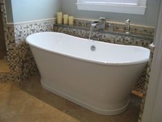 bathrooms with freestanding tubs | Traditional bathroom featuring a freestanding tub with adjacent shelf ...