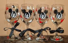 4 Mickey Mouse or Minnie Mouse themed wine glasses.
