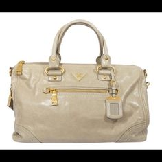 Prada Vitello Shine in Pomice Authentic PRADA Vitello Shine Tote in Pomice. This stylish tote is crafted of luxuriously grained soft calfskin beige leather. Features rolled leather top handles w/ large gold ring loops & an optional shoulder strap w/ gold clasps. Top of the bag is open to a partitioned Prada monogram fabric interior. This is an excellent tote, ideal for everyday essentials, with the stylish sophistication of Prada! Great preloved condition! Pls see extra pics Size: Length…