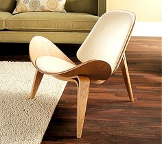 Shell Chair-1963 This chair has three-legged base, the chair is firm and stands well on the floor. The three legs creates balance making the chair not to fall over. Its a sleek and simple design.