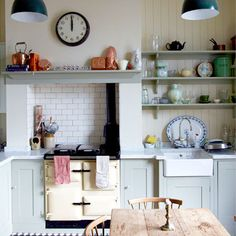 Like a lot in this country-style kitchen - shaker unit doors, tiles, traditional aga, butler's sink, paneling. Country Kitchen Interiors, English Country Kitchens, Aga Kitchen, Kitchen Yellow, Nice Kitchen, Shaker Kitchen, Kitchen Sinks, Kitchen Cupboards, Kitchen Island