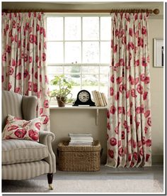 LAURA ASHLEY. This would be great for a reading nook. Like the calm with the smile from the poppy print.