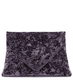 Dries Van Noten - Crushed velvet clutch - When it comes to plush texture, nothing quite hits the spot like crushed velvet. This boxy clutch bag from Dries Van Noten channels a mysterious mood with its rich purple hue and envelope-inspired design. Carry your essentials in its leather-lined interior. seen @ www.mytheresa.com