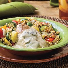 Creamy Slow-Cooker Chicken | Deceptively rich, low-fat Creamy Slow-Cooker Chicken with Roasted Vegetables and Rice combines everything we love about healthful comfort food.