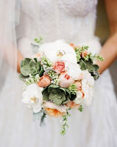 The bridal bouquet will be a small, asymmetrical, clutch bouquet of white phalaenopsis orchids, mint green succulents, peachy pink garden roses, white lilac, gray dusty miller, white balsa wood flowers, silver brunia, and peach ranunculus wrapped to the ends of the stems in ivory ribbon with gold pearl pins.