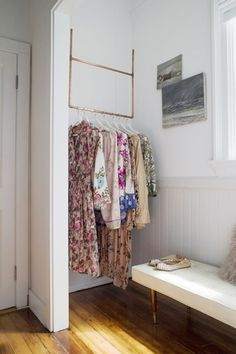 Floral dresses and tunics are too beautiful to be tucked away in a closet. Show them off instead by hanging them in the hallway outside your bedroom — they're still easy to grab, but double as decor. See more at Pottery Barn »