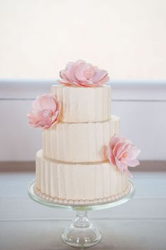 cute cake with pink magnolia sugarflowers
