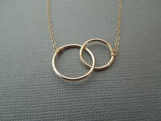 two gold circles intertwined simple expectant by greygoosegifts