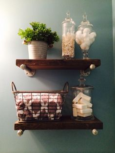 "Super cute and easy shelf for above the toilet. Two 20"" pieces of 8x2 inch pine, stain, 4 floor flanges, four 8"" nipples and four caps. Add a watered-down gray paint over the stain  for a weathered look."