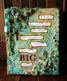 mixed media canvas using charms and findings