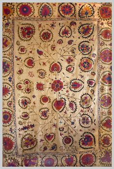A large Bokara embroidered dowry susani Silk on linen.  Circa 1870 -1880.   Designed with the centre tree design split, one half gold the other black.   This could be e reference to the joining together of family's in marriage.   The border design has no repeat and has 26 differing flower designs.   Measurements: 60 in x 84 in - 2000 cm's x 1550cm's
