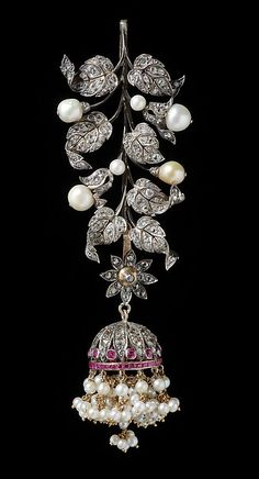 Plait Ornament (jadanagam) Object Name: Hair plait ornament Date: 1890–1910 Geography: South India Medium: Silver, set with diamonds, rubies, and pearls