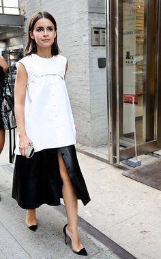Sleeveless white boxy blouse + black leather snap midi skirt + black d'orsay pumps :: White + black chic :: Miroslava Duma