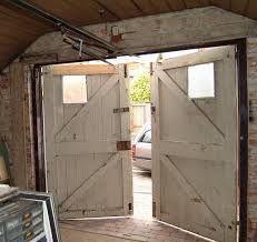 Image result for wooden garage doors on barn