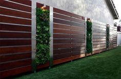 Gorgeous & functional Ipe wood fence with vertical gardens. Outdoor Living Design Ideas We Love at Design Connection, Inc. | Kansas City Interior Designer
