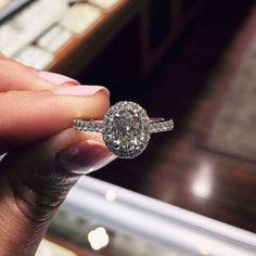 gorgeous oval halo engagement ring