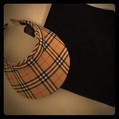 ♠️Burberry Visor♠️ Take the country club by storm in this sun visor from Burberry! Unisex style, in near perfect condition aside from a slight makeup stain on the terrycloth, which should be removable if dry cleaned. Priced to sell! 100% authentic, purchased at Nordstrom. TRADESLOWBALLINGPAYPAL ✅BUNDLES✅REASONABLE OFFERS✅ Happy Poshing!  Burberry Accessories Hats