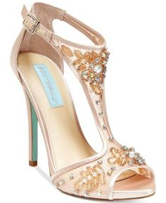 Breathtakingly beautiful and embellished with beading, these sexy, sky-high heels from Blue by Betsey Johnson will definitely have all eyes focused on you.   Shimmer metallic fabric or satin upper; ma