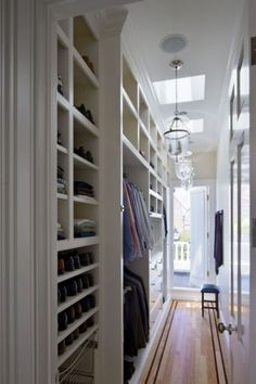 Instead of a walk-in closet, turn a small hall into an open closet. Implementing tidy open shelving and hanging rods negates the need for doors, which would impede traffic flow through the hallway.