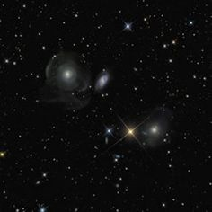 """Shell Galaxies (NGC474 and NGC467), by Marco Lorenzi. Winner Astronomy Photographer of the Year 2011 for an image taken by a remote telescope and processed by the the entrant. Even the images you see from the Hubble Space Telescope have been processed from raw data - it's an important part of making sense of the data. ©Mona Evans, """"Astronomy Photographer of the Year 2011"""" http://www.bellaonline.com/articles/art50195.asp"""