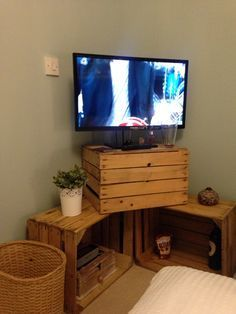 Looking for an elegant TV stand to add to your room? Here's a collection of 23 free DIY TV stand plans with a variety of sizes and styles for you Crate Tv Stand, Diy Tv Stand, Bed Stand, Tv Stand Made From Crates, Cheap Tv Stand, Bedroom Tv Stand, Wooden Apple Crates, Wooden Crates Tv Stand, Pallet Tv Stands