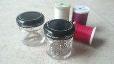Mini single-use mayo/honey jars used to store safety pins and needles.