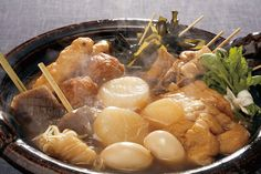 Oden is a Japanese winter dish consisting of several ingredients such as boiled eggs, daikon, konjac, and processed fishcakes stewed in a light, soy-flavored dashi broth.