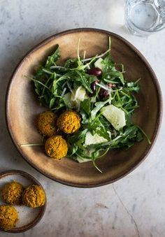 Sweet Potato and Turmeric Falafels and baked in the oven for an easy and healthy weeknight meal. Enjoy them on top of a salad, in a pita wrap, or on its own with a drizzle of traditional tzatziki dressing.