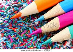 Keep it Sharp!  Macro of four bright-colored pencils on pencil shavings