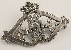 "Rare Victorian circa 1850's Scottish silver ""Mary""  Luckenbooth pin.   The brooch has the classic double M which was used by Mary Queen of Scots as her monogram. The Scottish crown sits proudly on the top making this THE classic ancient Scottish brooch design!I"