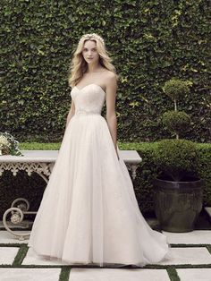 Spring 2016 | Casablanca Bridal A soft tulle #ballgown with a #sweetheart neckline. Delicate beading glimmers on the bodice and flows throughout the full skirt. #weddinggown