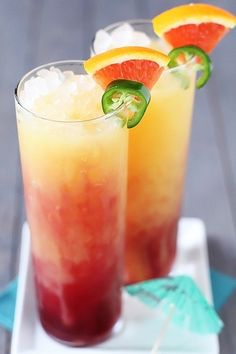 Tequila Sunrise, with tequila, orange juice and grenadine syrup. Add a slice of jalapeno to give it a spicy kick.