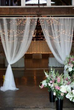 gorgeous mesh draped curtains for the bridal entry and a twinkle light backdrop at Green Villa Barn in Independence, OR. Just 10min from Salem, Oregon