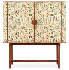 A Josef Frank mahogany cabinet covered in Frank's floral chintz fabric 'Fatima' by designers Svenskt Tenn, ca.1937