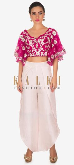 Buy Online from the link below. We ship worldwide (Free Shipping over US$100)  Click Anywhere to Tag Rani pink crop top blouse embellished in resham with dhoti pants only on Kalki Rani pink crop top blouse featuring in silk.Its embellished in resham embroidery along with zardosi.It comes with fancy sleeve.Matched with dhoti pants in pink crepe silk. Pink Crop Top, Fancy, Crop Tops, Embroidery, Free Shipping, Silk, Blouse, Sleeve, Stuff To Buy