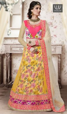 Awesome Yellow Net A-Line Lehenga Choli  Awesome yellow net a-line lehenga choli created with embroidered work, resham work, buttis work, zari work, lace and patch border work.Comes with matching choli and dupatta