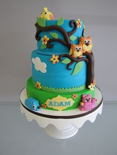 Woodland Theme Baby Shower Cake. With a creature to represent each of us.