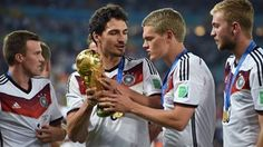Mats Hummels and Matthias Ginter celebrate with the World Cup trophy
